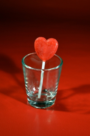 Lollipop in Shot Glass - Red Background