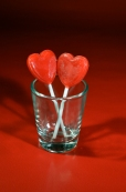 Lollipops in Shot Glass - Red Background